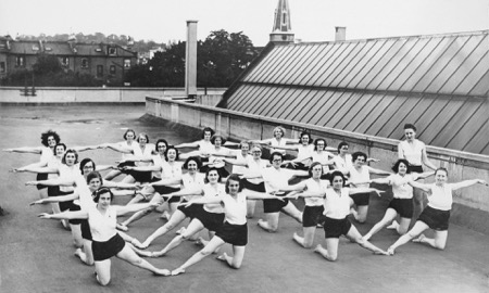 Image shows young women engaged in an exercise class